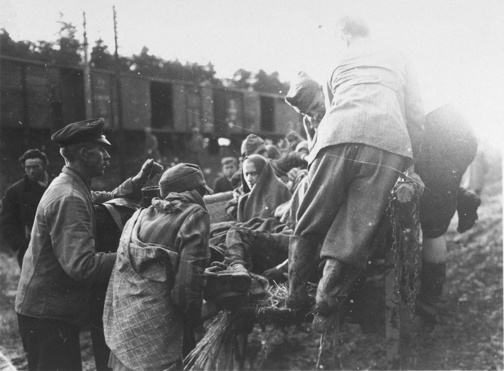 German civilians help evacuate survivors from the Schwandorf death train.