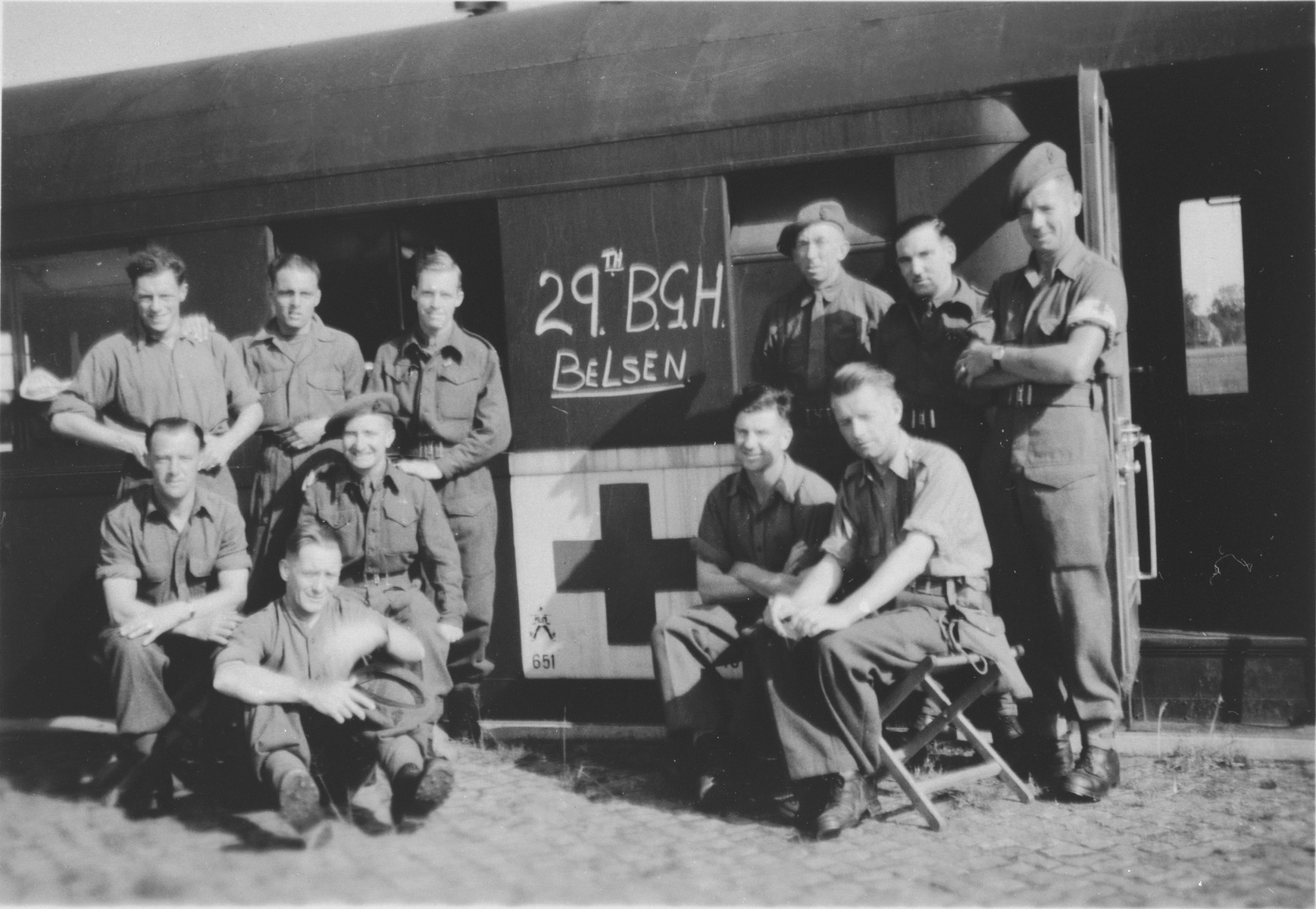 Group portrait of the staff of the ambulance train that took survivors from Bergen-Belsen to Sweden for recuperation.