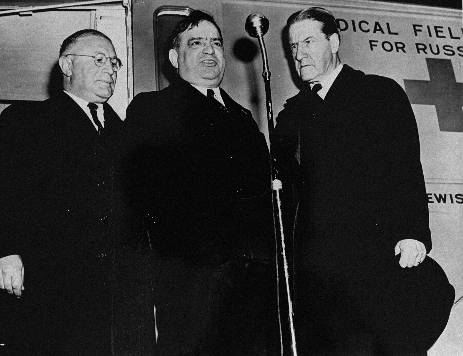 Dr. Joseph Tenenbaum (center) stands with Fiorello LaGuardia (left) and Rabbi Stephen S. Wise (right) in front of a medical field unit sponsored by the United Jewish War Effort that is being sent to the Soviet Union.