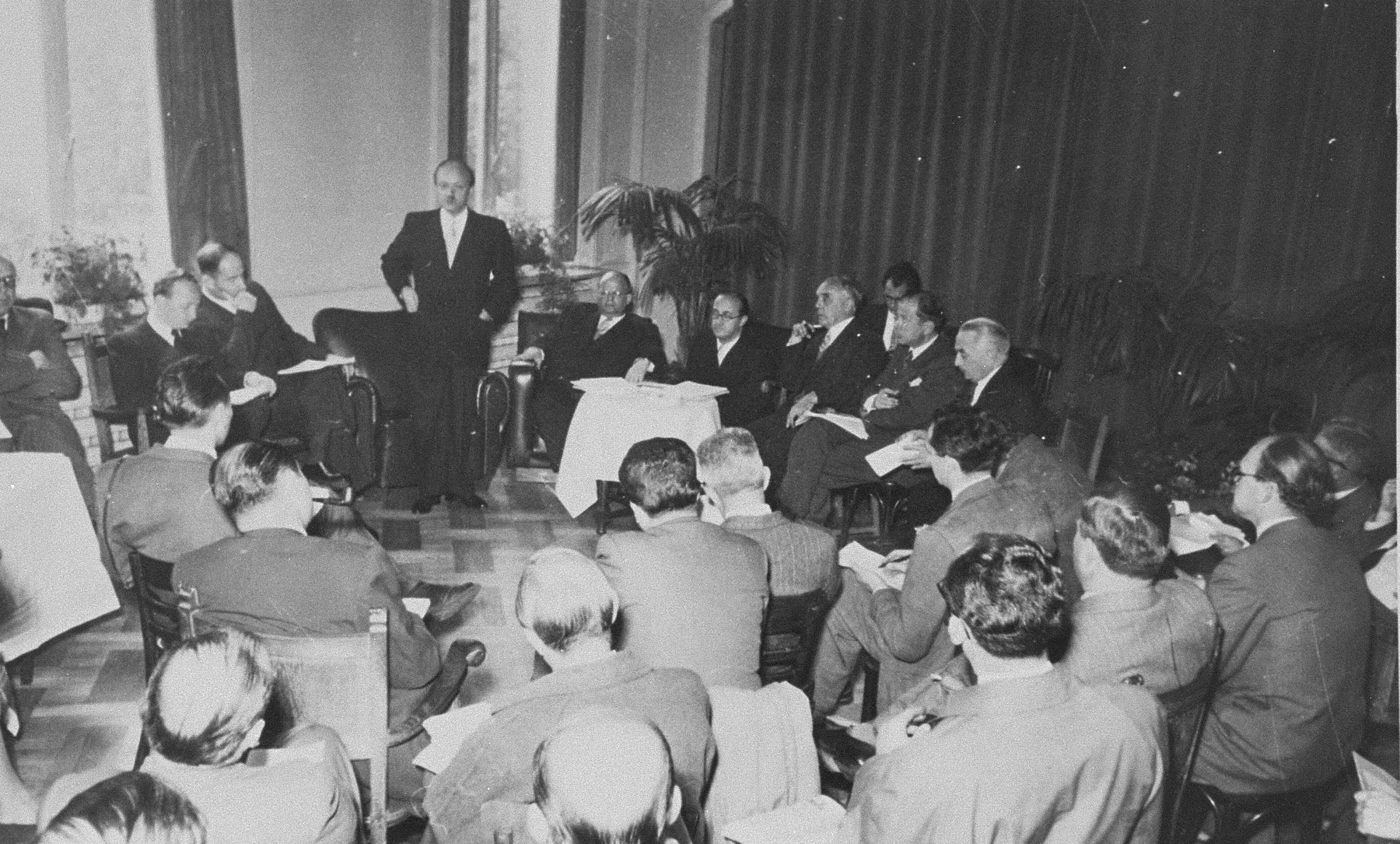 A briefing by members of the Conference on Jewish Material Claims in Luxembourg during the signing of the Reparations Agreement between the German Federal Republic, the State of Israel, and the Conference on Jewish Material Claims.    Among those pictured is Benjamin Ferencz (second from the left).