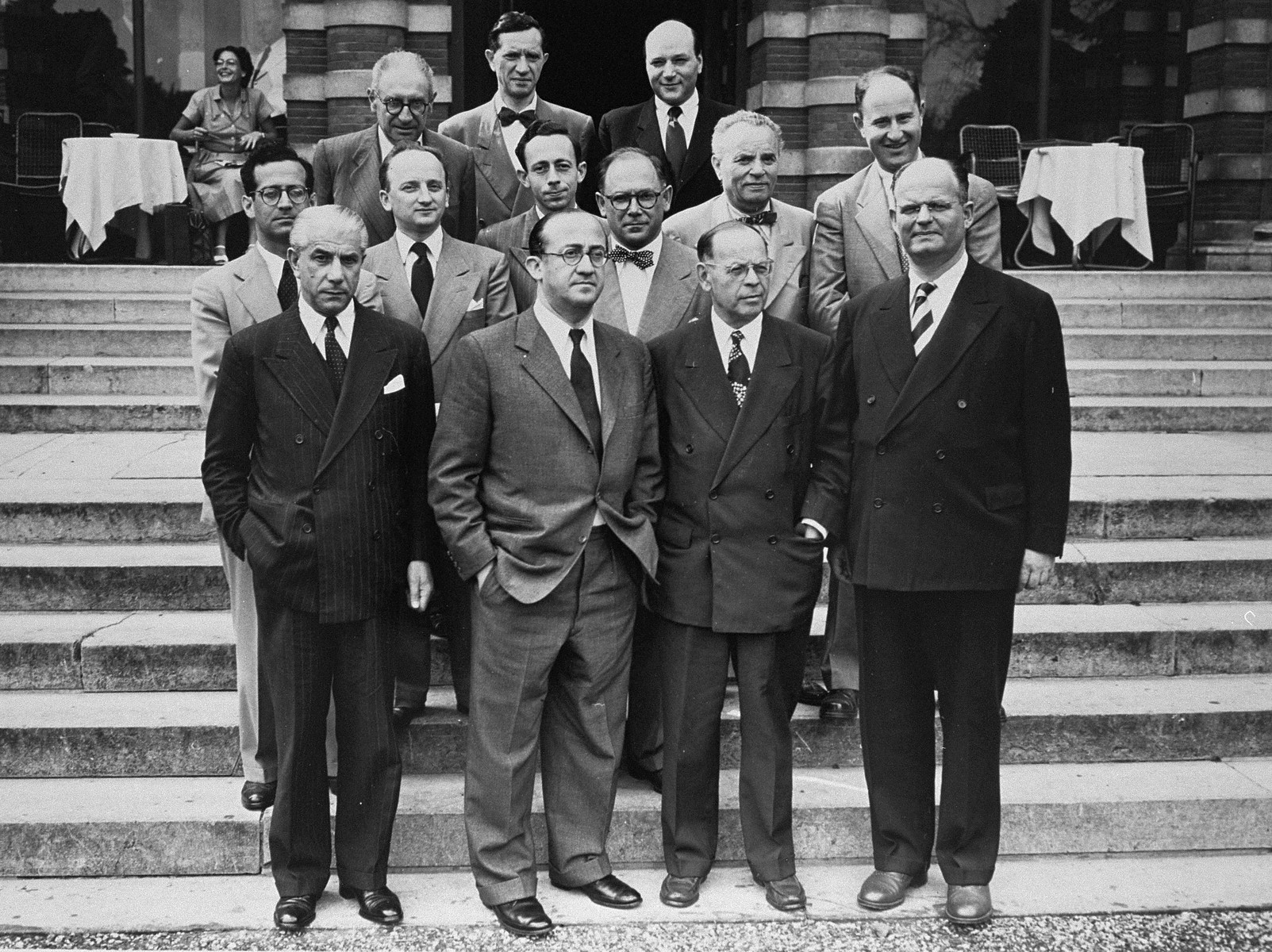 Group portrait of members of the Conference on Jewish Material Claims that came to Luxembourg for the signing of the Reparations Agreement between the German Federal Republic, the State of Israel, and the Conference on Jewish Material Claims.   Among those pictured is Benjamin Ferencz (second row from the front, second from the left).