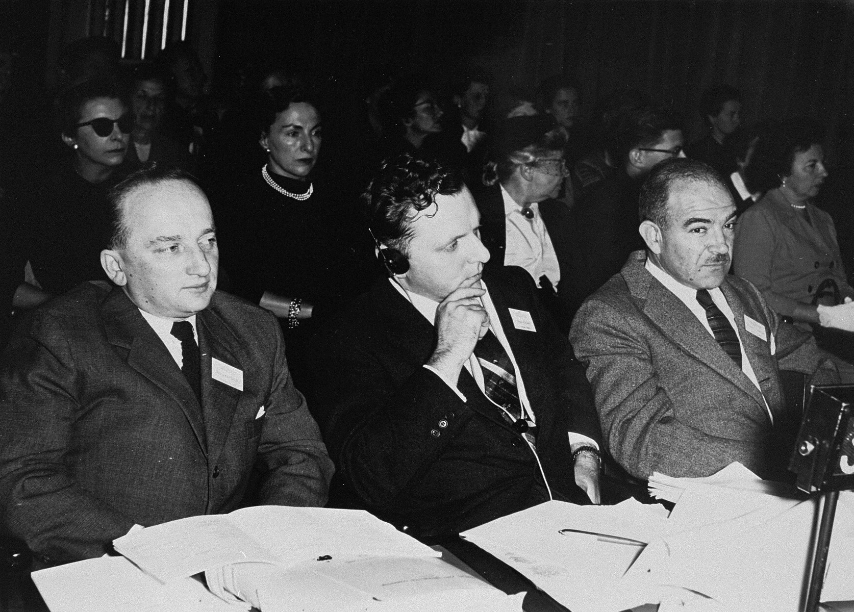 Three Jewish leaders participate in the tenth annual Country Directors Conference of the American Jewish Joint Distribution Committee at UNESCO House.    Pictured from left to right are: Benjamin Ferencz, Director-general of the Jewish Restitution Successor Organization; Saul Kagan, Secretary of the Conference on Jewish Material Claims; and Dr. Judah J. Shapiro, Cultural Director of the Conference on Jewish Material Claims.