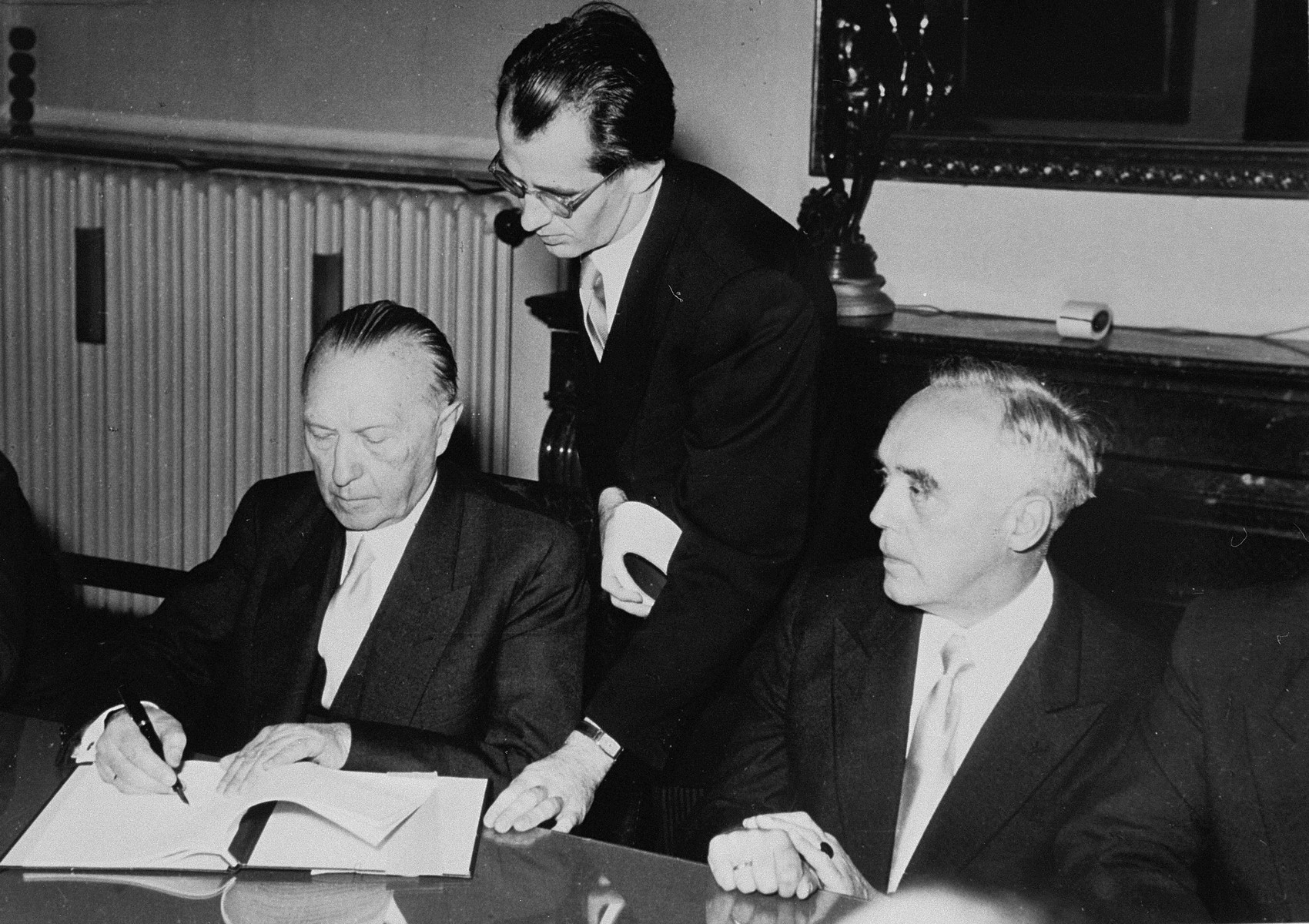 The first Chancellor of post-war West Germany, Konrad Adenauer, with his aide Prof. Boehm, at the signing of the Reparations Agreement between Israel, West Germany, and the Committee on Jewish Material Claims.