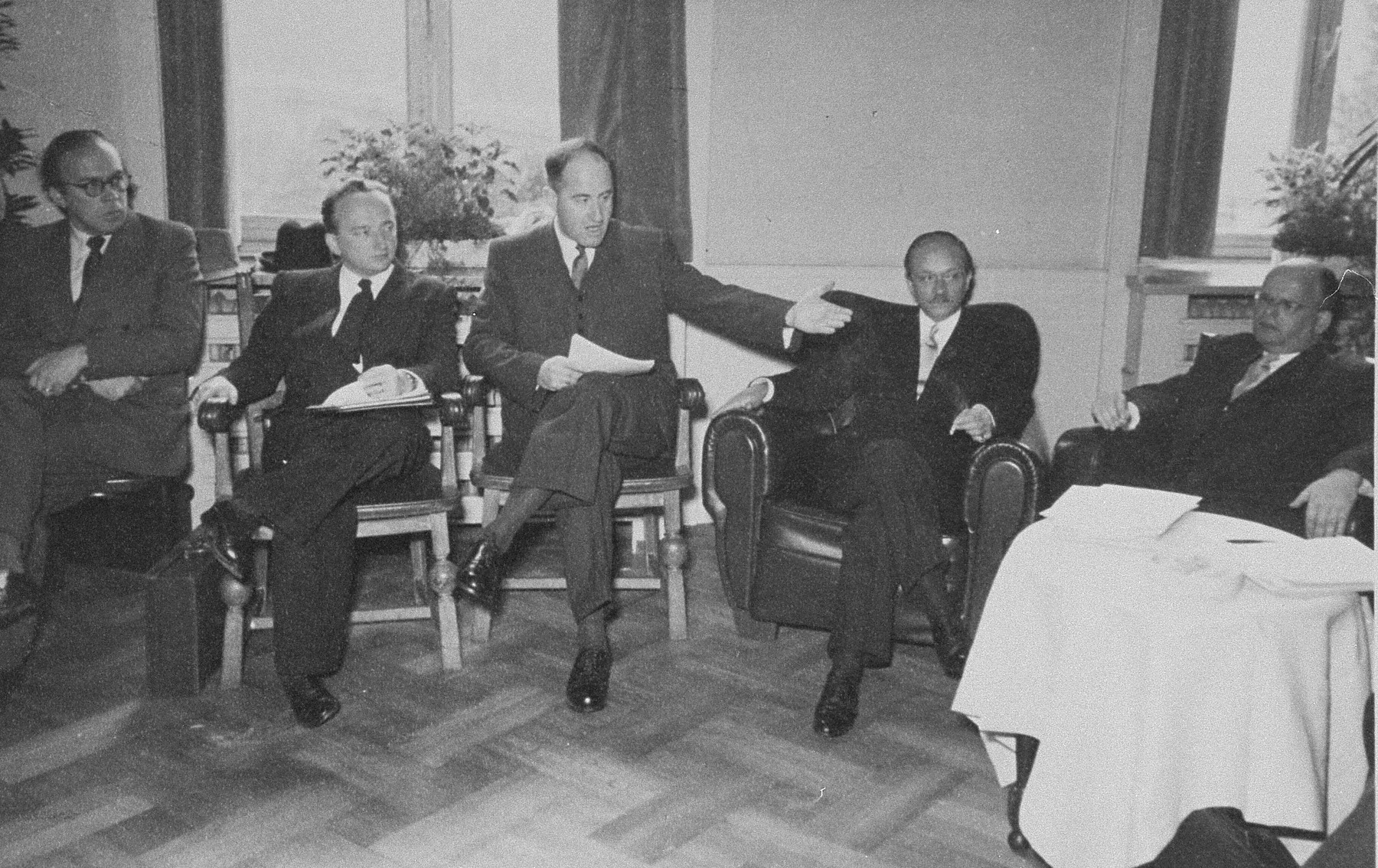 Members of the Conference on Jewish Material Claims meet in Luxembourg for the signing of the Reparations Agreement between the German Federal Republic, the State of Israel, and the Conference on Jewish Material Claims.    Among those pictured is Benjamin Ferencz (second from the left).