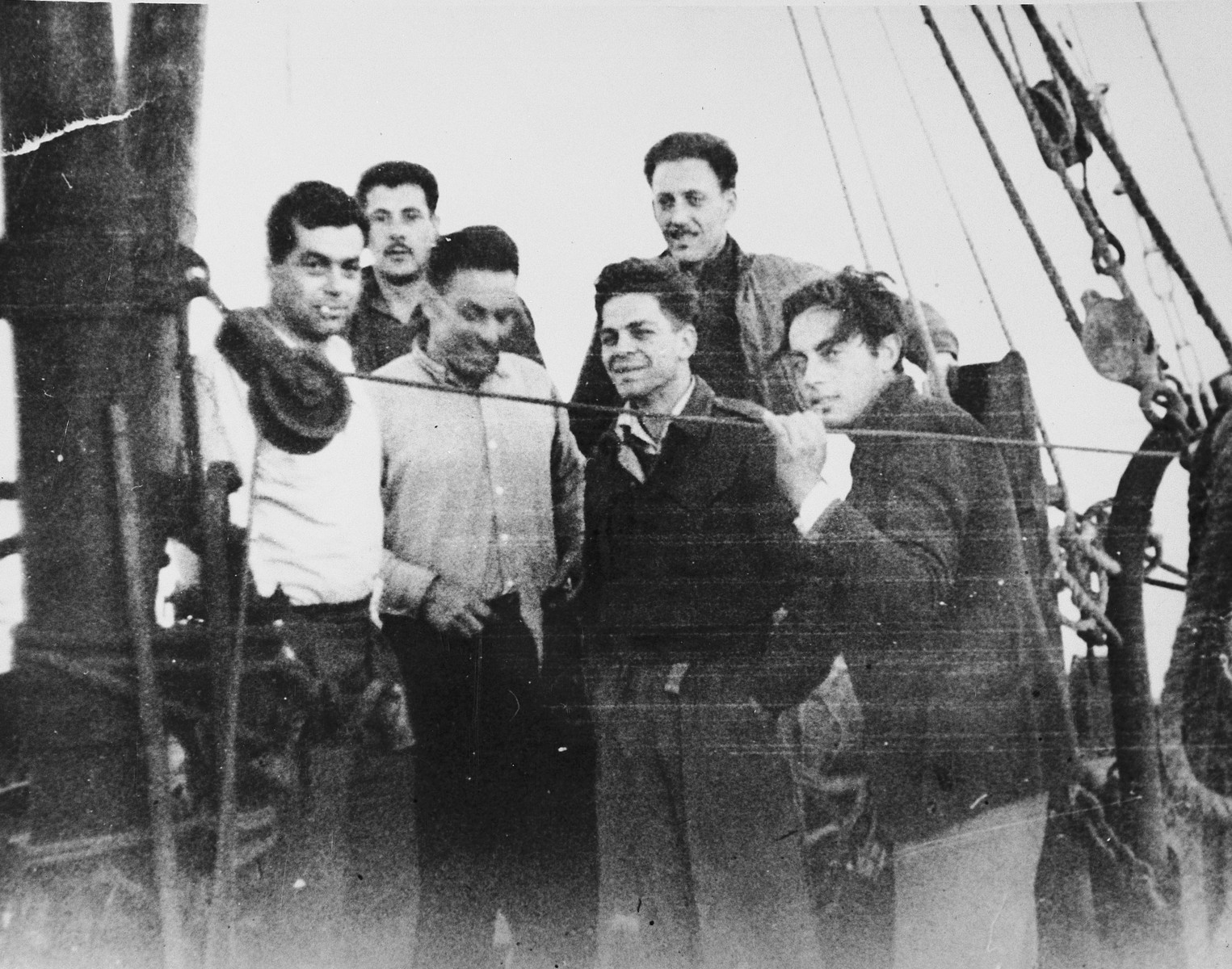 Former crew of the Pan Crescent and Pan York, many of whom had also been on the crew of The Exodus, sail from Cyprus to Caesaria on board the Nesher.   The first man in the back row has been identified as David Lowenthal.