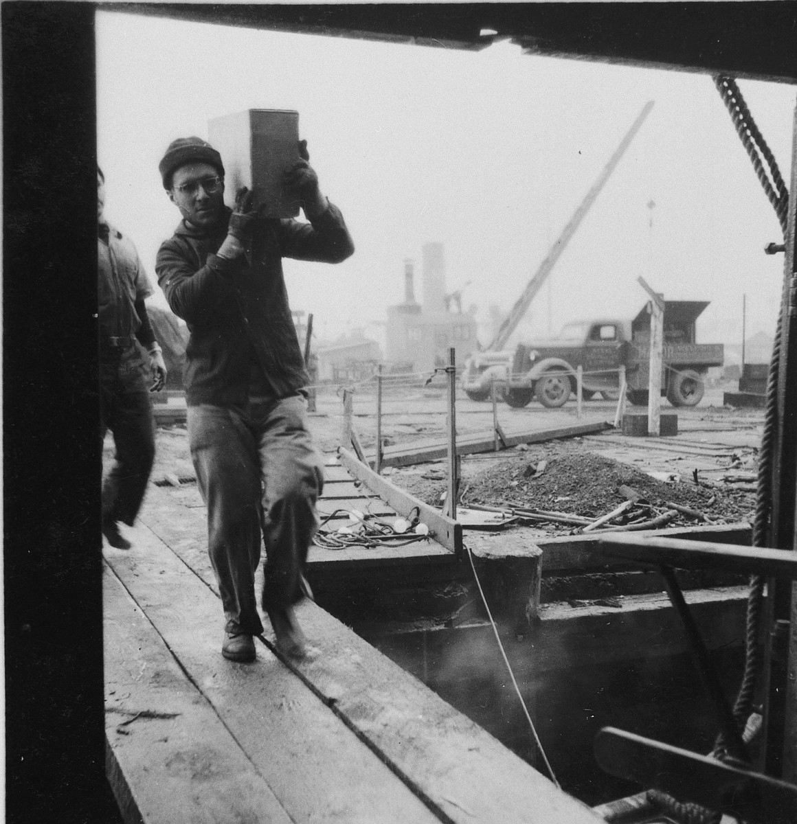 A crew member loads cargo onto the President Warfield (later the Exodus 1947).