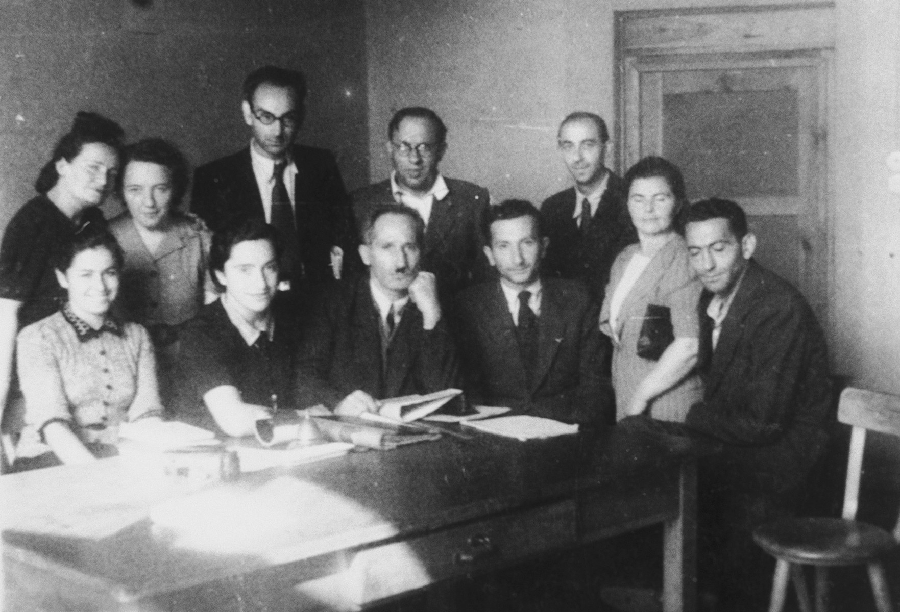 Teachers of the Szczecin Peretz Yiddish School.  Those pictured include Genia Kac-Storch (second from the left) and Lev Tenenbaum (second from the right).