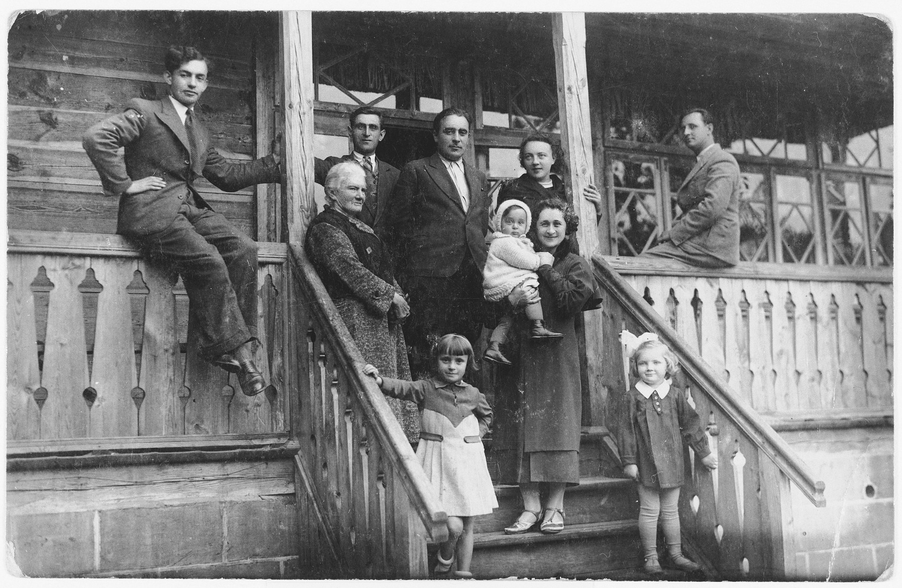 A group of friends and relatives vacation together in a wood summer home outside of Bielsk Podlaski.  Among those pictured are Helena Storch, her mother Genia Storch and grandmother, Tsivia Kac.