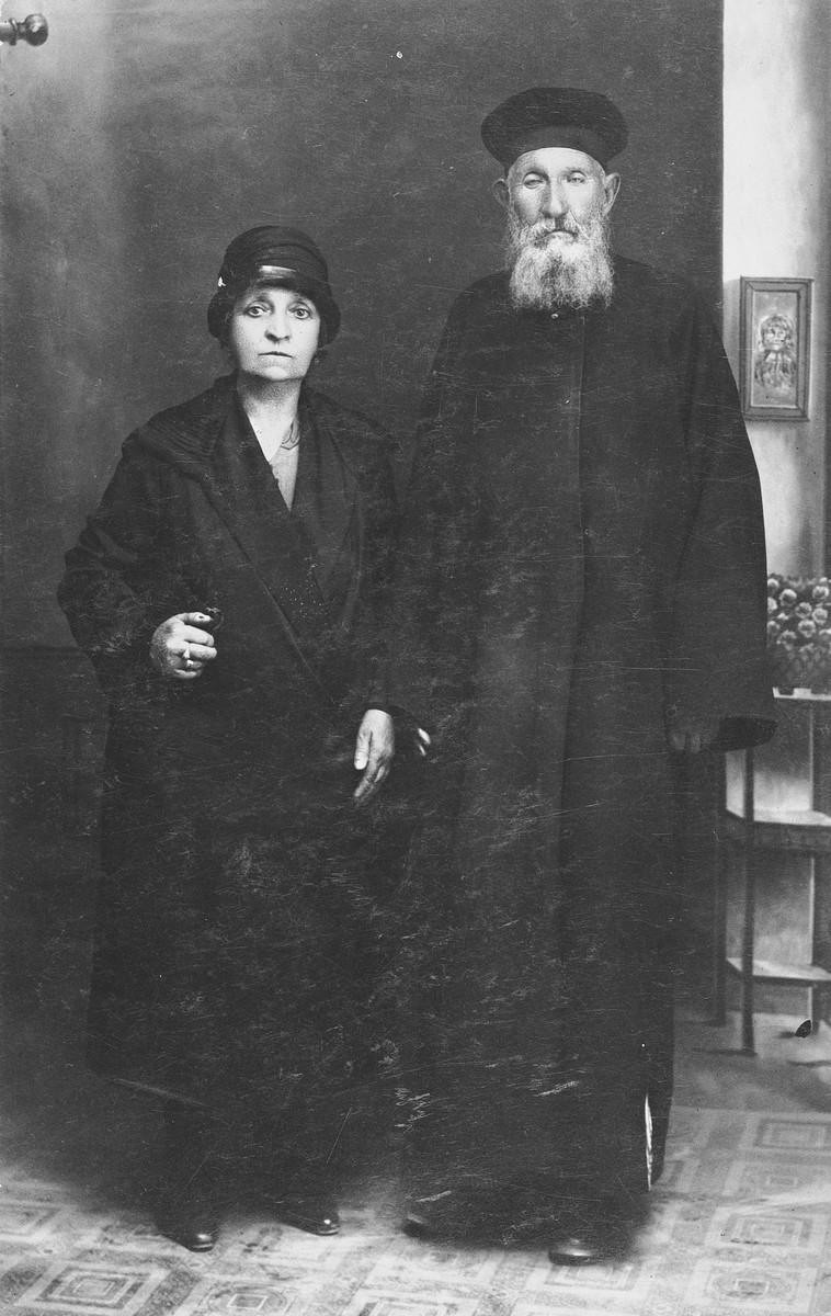Studio portrait of an elderly Jewish couple in Salonika.