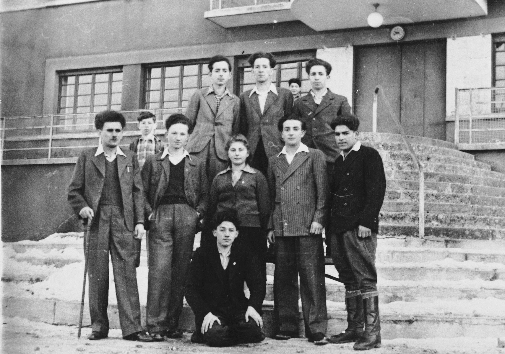 Chana Scheiner poses with a group of boys outside the Selvino children's home.  Also pictured are Chaim Bernstein (senior leader of Gordonia) on the far left, Chaim Lagazhitsky (middle row, second from the right) and and Twi Margulies (top row, center).