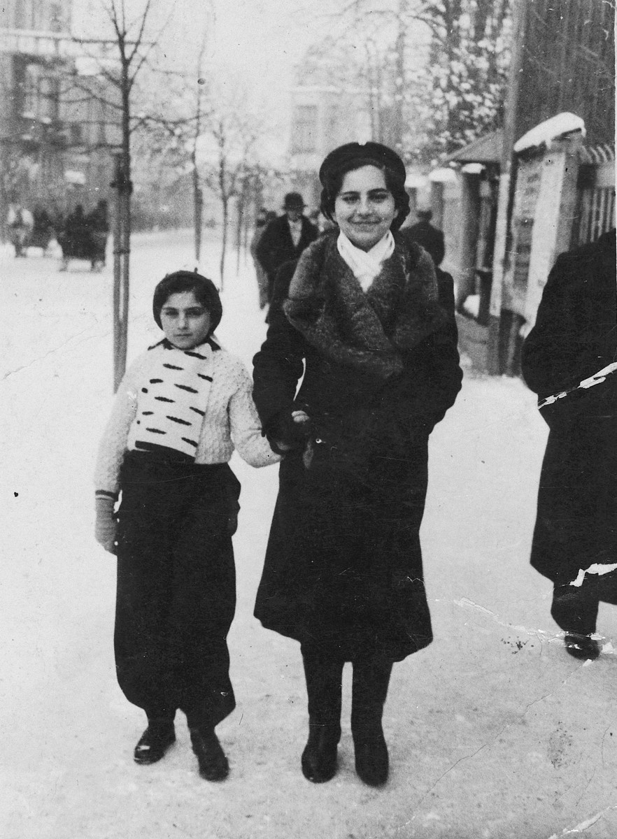 A mother and daughter walk down a snowy street in Poland.  Pictured are Zlata and Gabrila Knoebel.