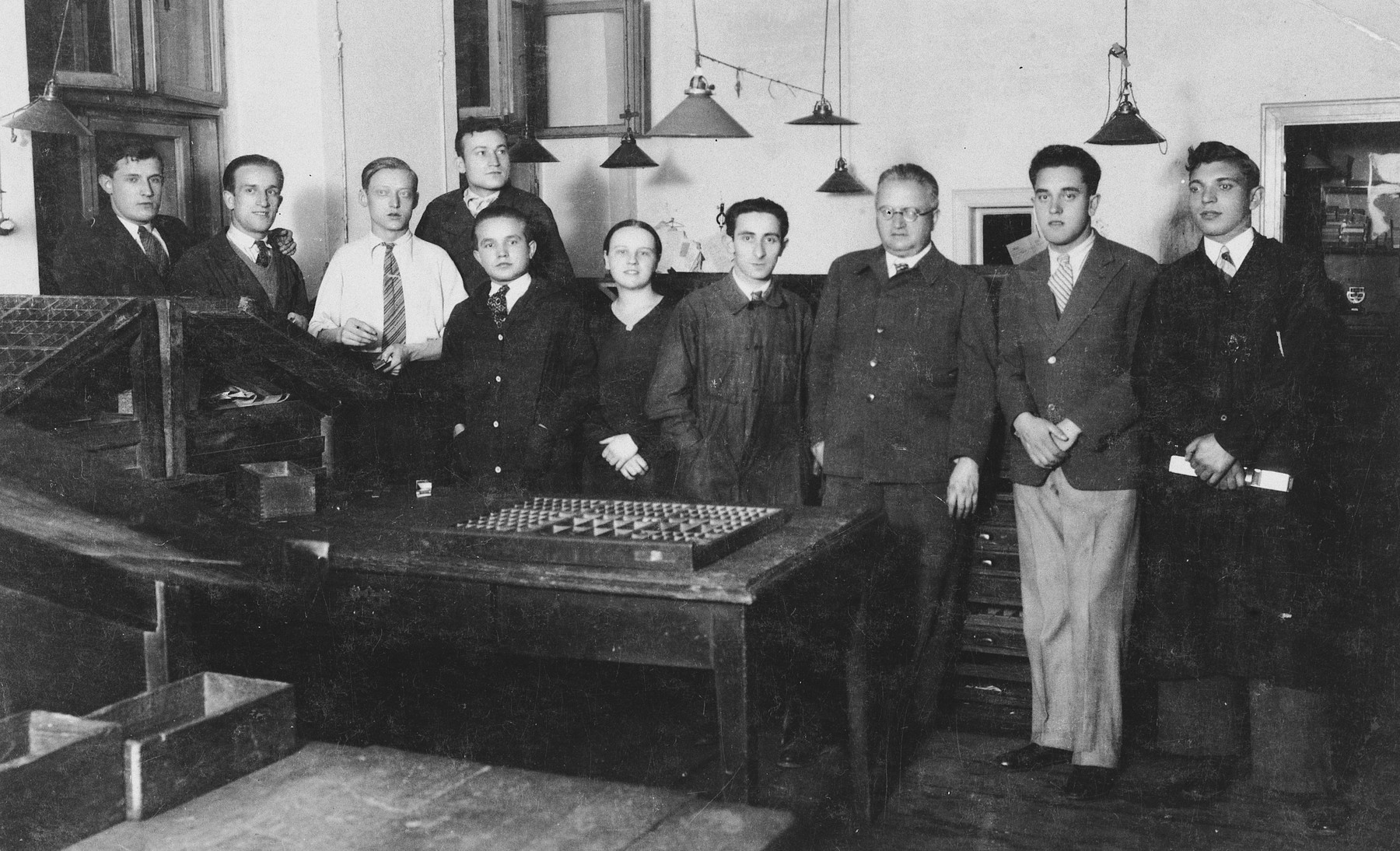 Polish and Jewish workers in a printing press in Kalisz.  Among those pictured is Heniek Storch (fourth from the right) who was head of his section.