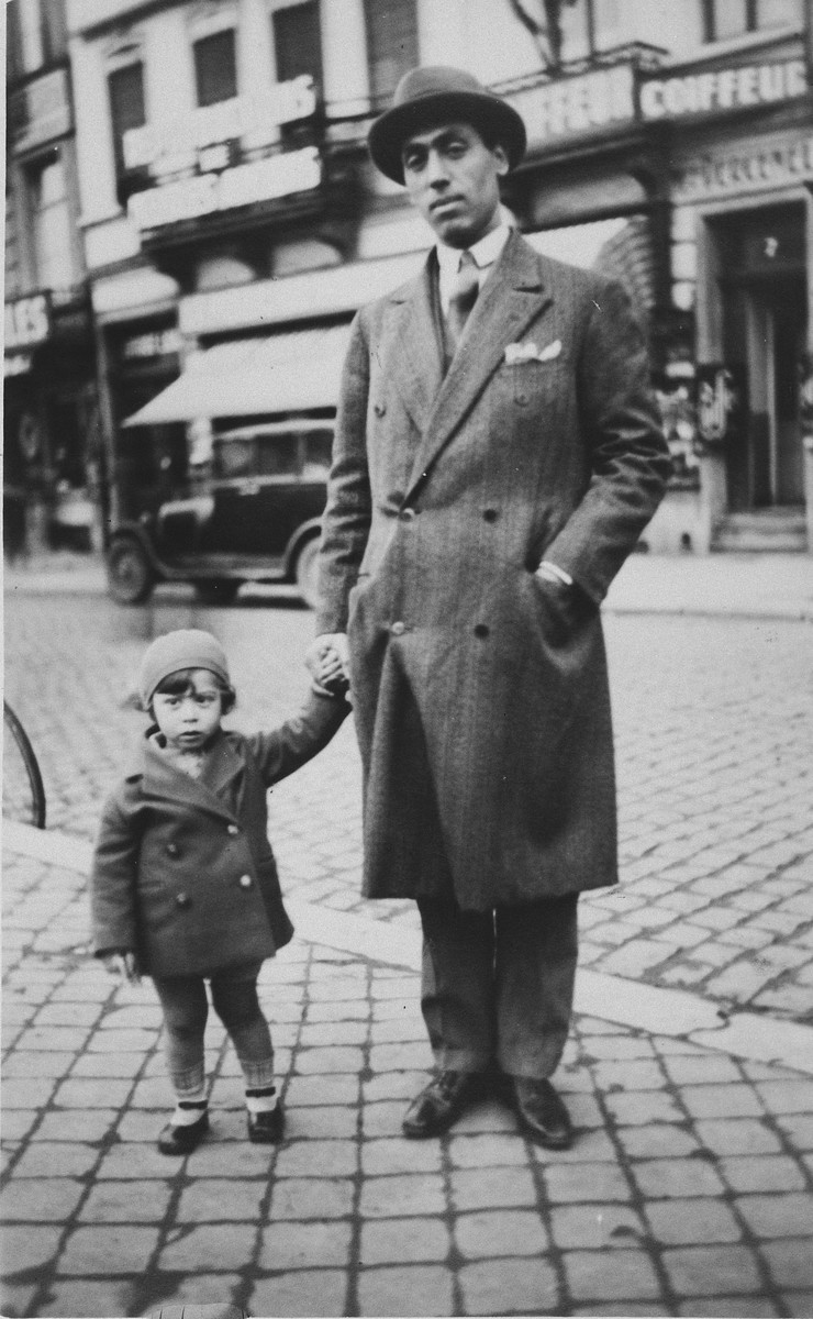 Michelene Frances walks down a street in Brussels with her father.