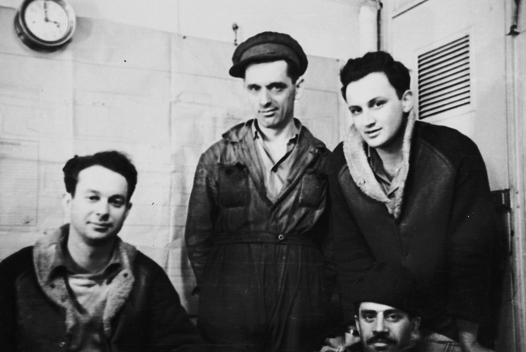 Four crew members of the Pan Cresent (Atzmaut) pose in a room below deck.  Pictured from left to right are Chaim Goldis, a Romanian engineer Katz and Gad Lifshitz.  Pictured in front is Berchik Lifshitz (Dov Magan).  Goldis and Gad Lifshitz were radio operators and Dov Magan was the ship's commander.  They also belonged to the Palyam, the naval branch of the Palmach.  Goldis was a platoon leader and killed near Hulda at the end of March, 1948.