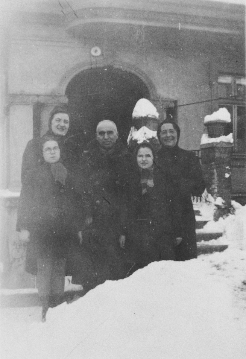 The Laszlo family poses outside their pension in Miskolc.  Pictured are Zoltan, Rosalia, Agnes and Zsuzsi Laszlo and an unidentified female teacher.