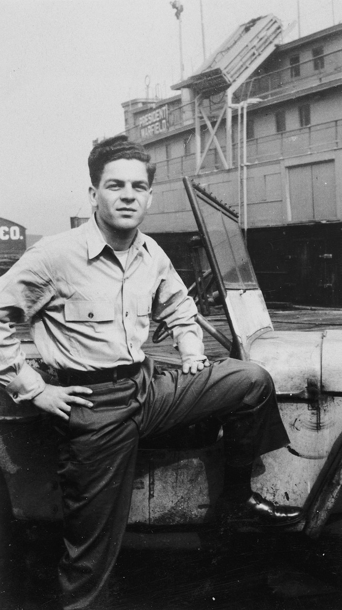 Arthur Lifshitz (later Avi Livni), a crew member of the President Warfield (later The Exodus 1947) poses near the ship in Baltimore harbor.