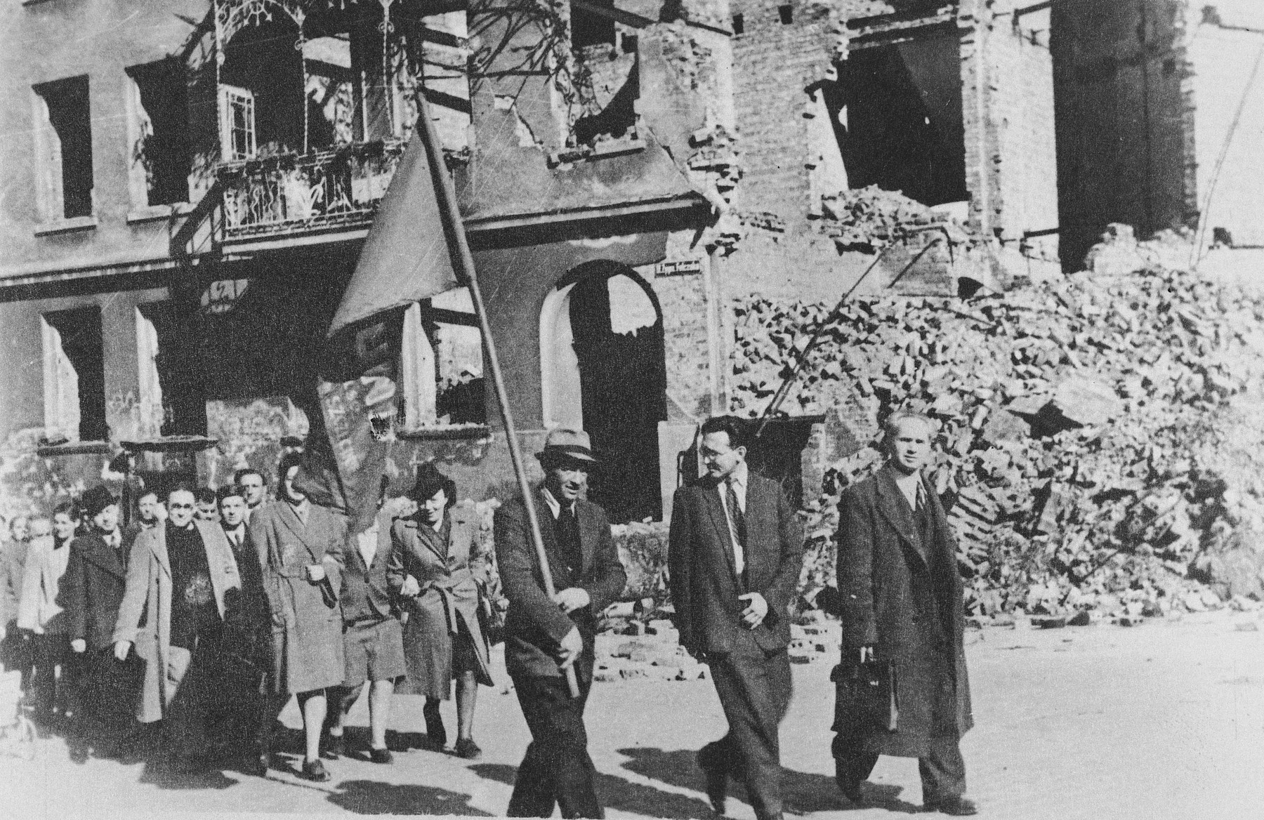 Jewish survivors march in a May Day parade in the bombed-out ruins of Szczecin.