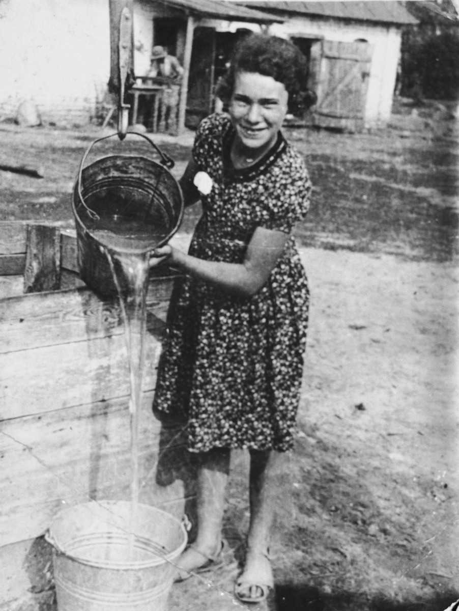 Genia Glowinski fetches water while on vacation in a small village.