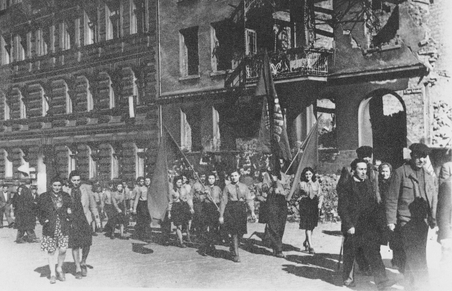 Helena Storch marches in a parade to commemorate the anniversary of the Warsaw ghetto uprising.