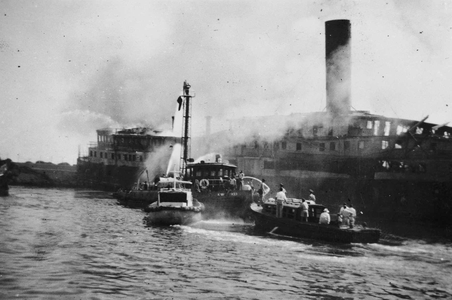 Fireboats try to put out a fire on the Exodus 1947 ship in Haifa harbor.