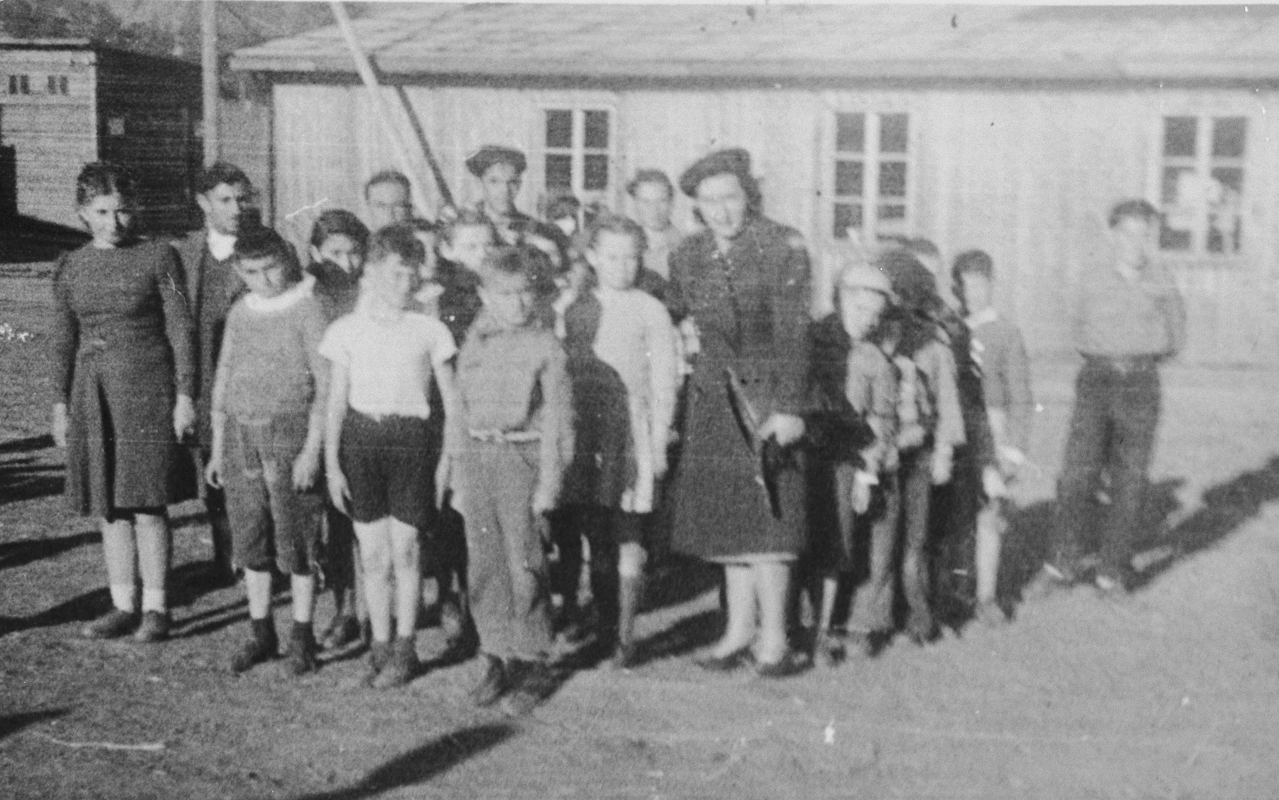 Chana Scheiner and an UNRRA representative accompany a group of young children on a transport from Poland to Italy.
