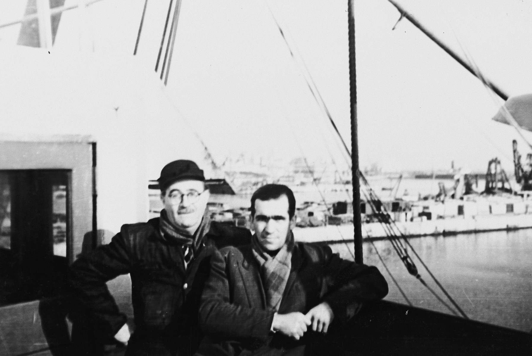 Two Romanian Jews pose in the port of Constanta before the sailing of the Pan Crescent (later renamed the Atzmaut).  Pictured is Ricu Lupu, a Romanian-born Palestinian Jew who parachuted into Romania to help the resistance.