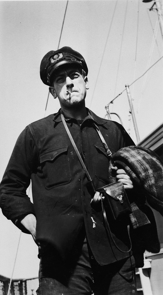 A crew member of the President Warfield (later the Exodus 1947) poses with a cigarette in his mouth on the deck of the ship.  Pictured is Cyril Weinstein, who served first as the ship's boatswain and later as its third mate.