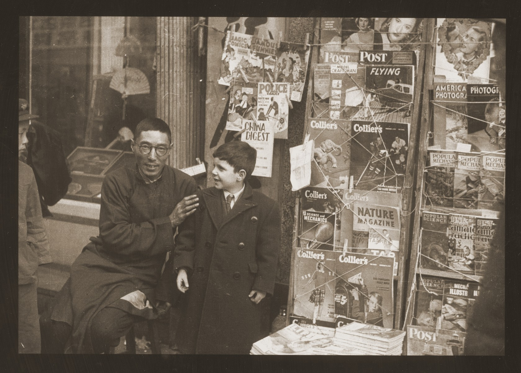 Harry Fiedler with a bookseller/fortune-teller on Tongshan Road in Hongkew.