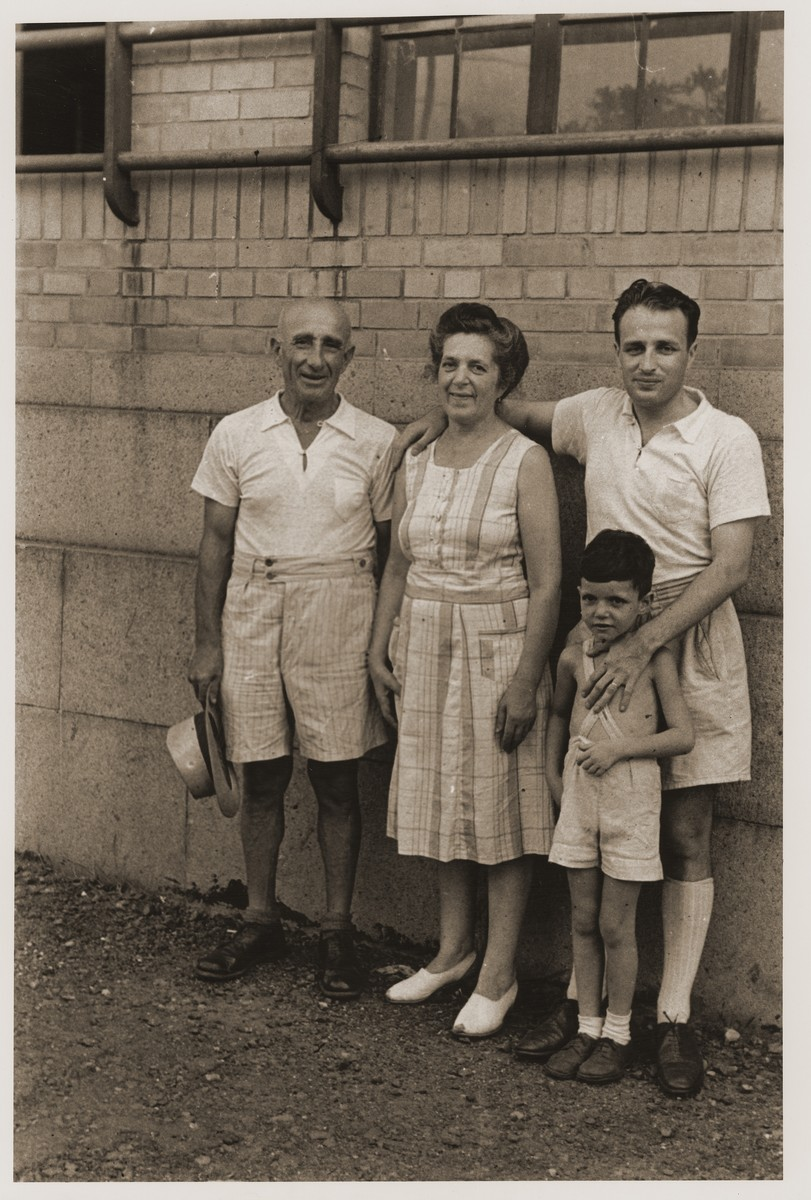 The Goldstaub family poses for a photograph with Harry Fiedler.    Pictured from left to right are Adolf, Camilla and Eric Goldstaub, who has his arm around Harry Fiedler.