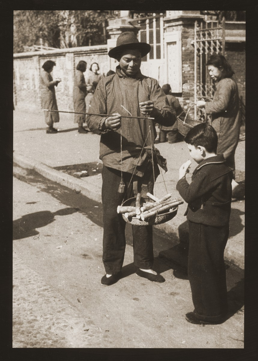 Harry Fiedler samples sugar cane from a street vendor on Chusan Road, Shanghai.