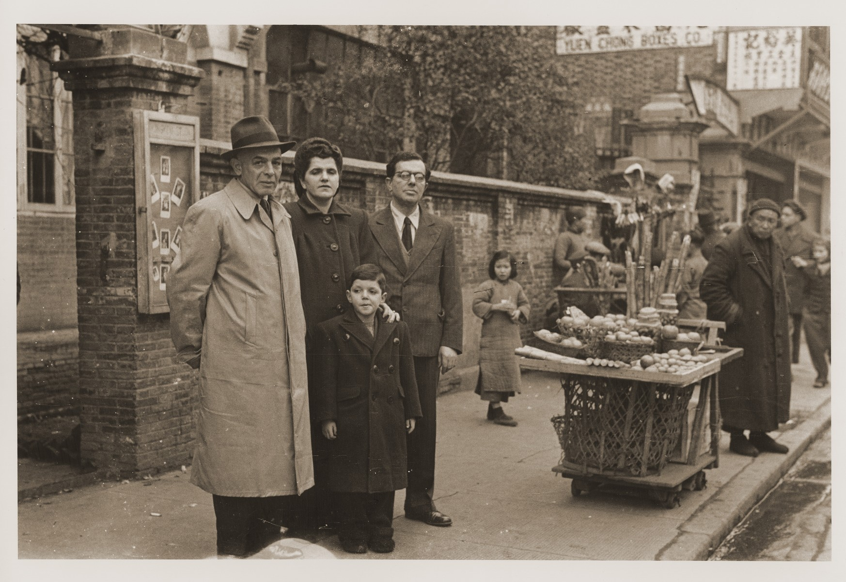 The Fiedler family poses in front of their home on Tongshan Road.    Pictured from left to right are Ernst Paschkes, Berta,  Harry, and Oskar Fiedler.