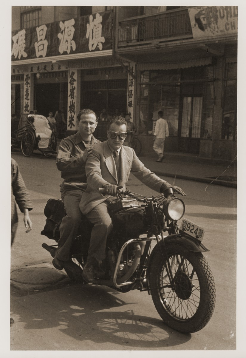 Eric Goldstaub rides a motorcycle with a friend on the streets of Shanghai.