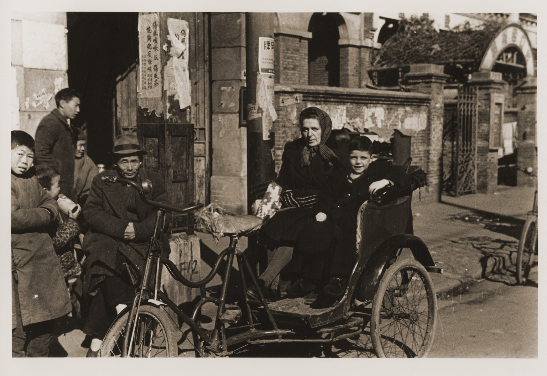 Austrian Jewish refugees Camilla Goldstaub and Harry Fiedler sit in a pedicab on Tongshan Road.