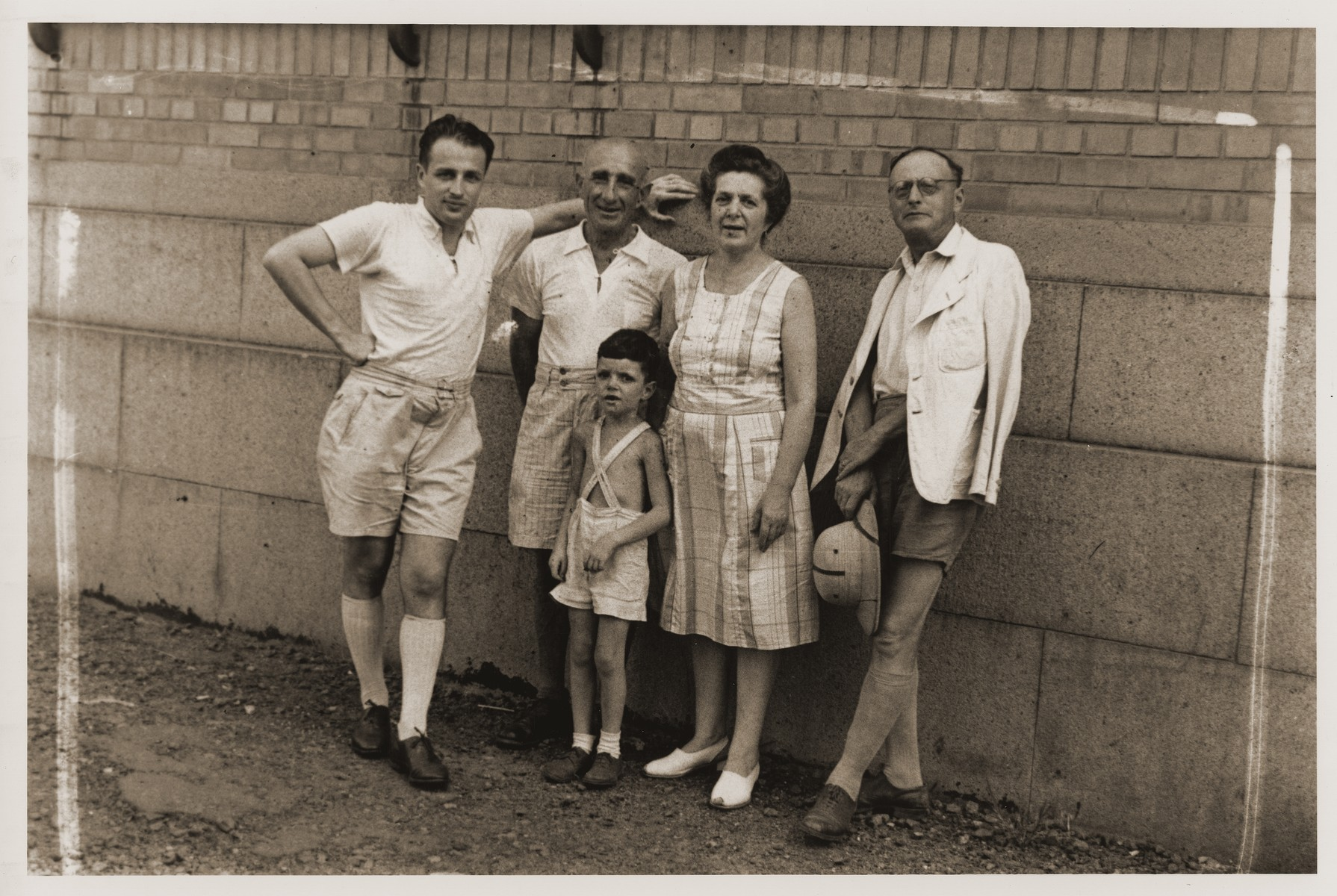 Members of the Goldstaub family pose with Harry Fiedler on a street in Shanghai.    Pictured from left to right are Eric and Adolf Goldstaub, Harry Fiedler and Camilla Goldstaub.