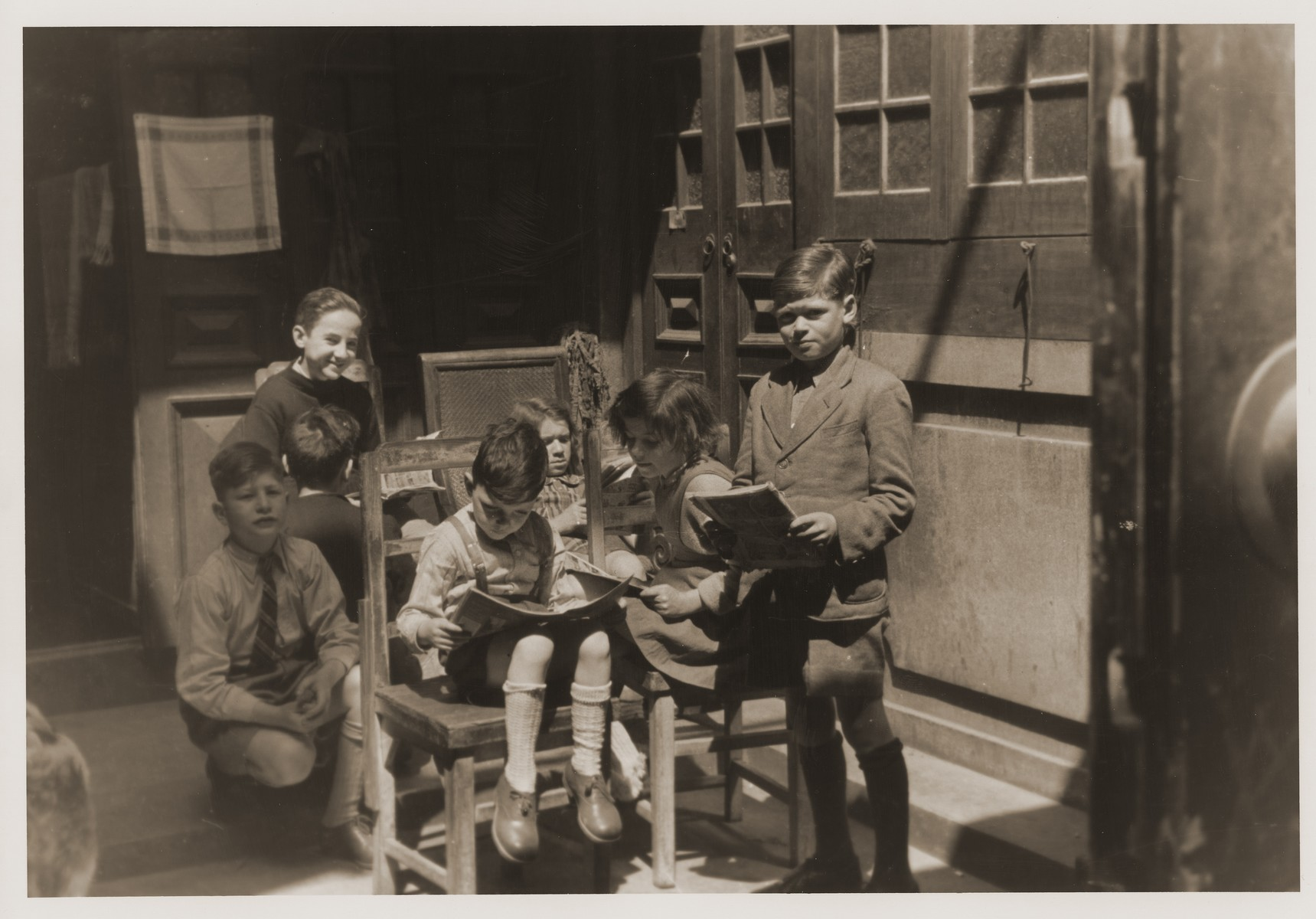 Jewish refugee children in a home on Tongshan Road.     Harry Fiedler is pictured reading in the chair.  Kneeling to his right is Werner Pendzl.