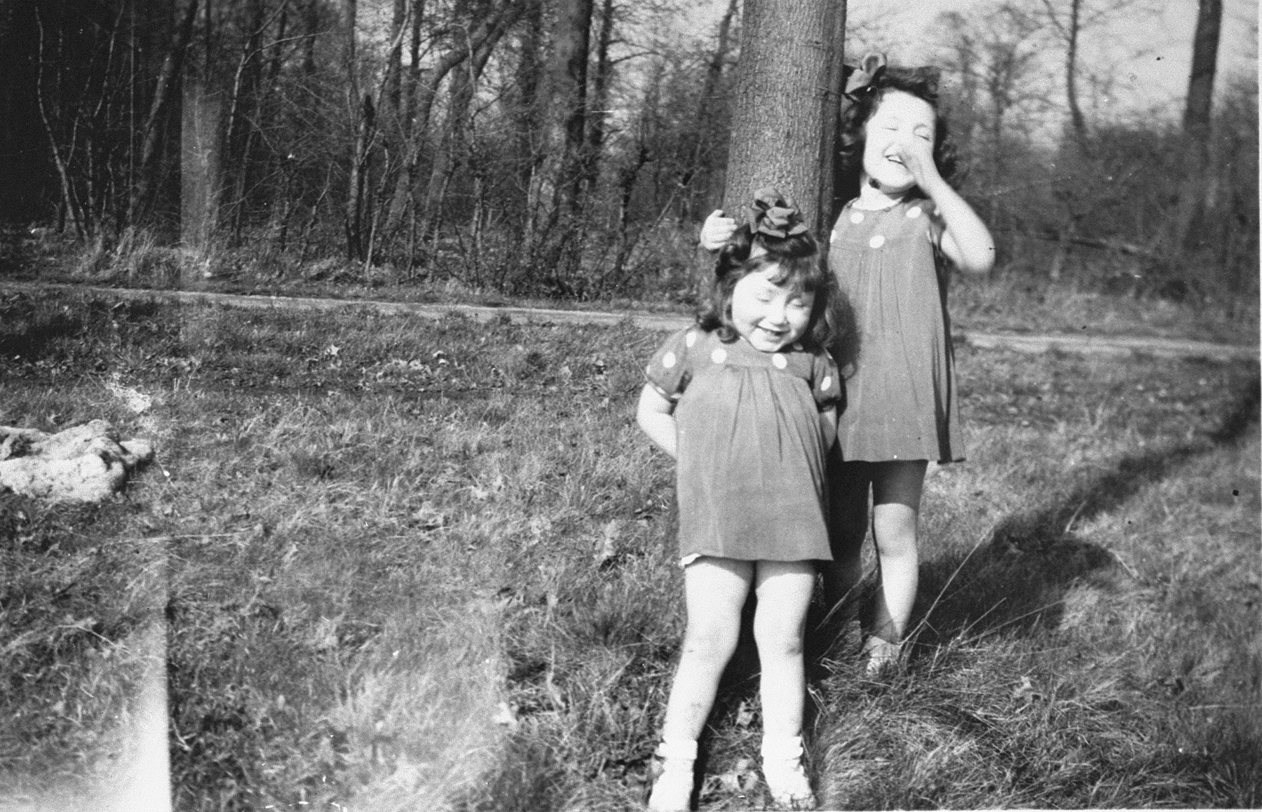 Margo and Annette Lederman, two Jewish children in hiding, play in the yard of the van Buggenhout home in Rumst, Belgium.