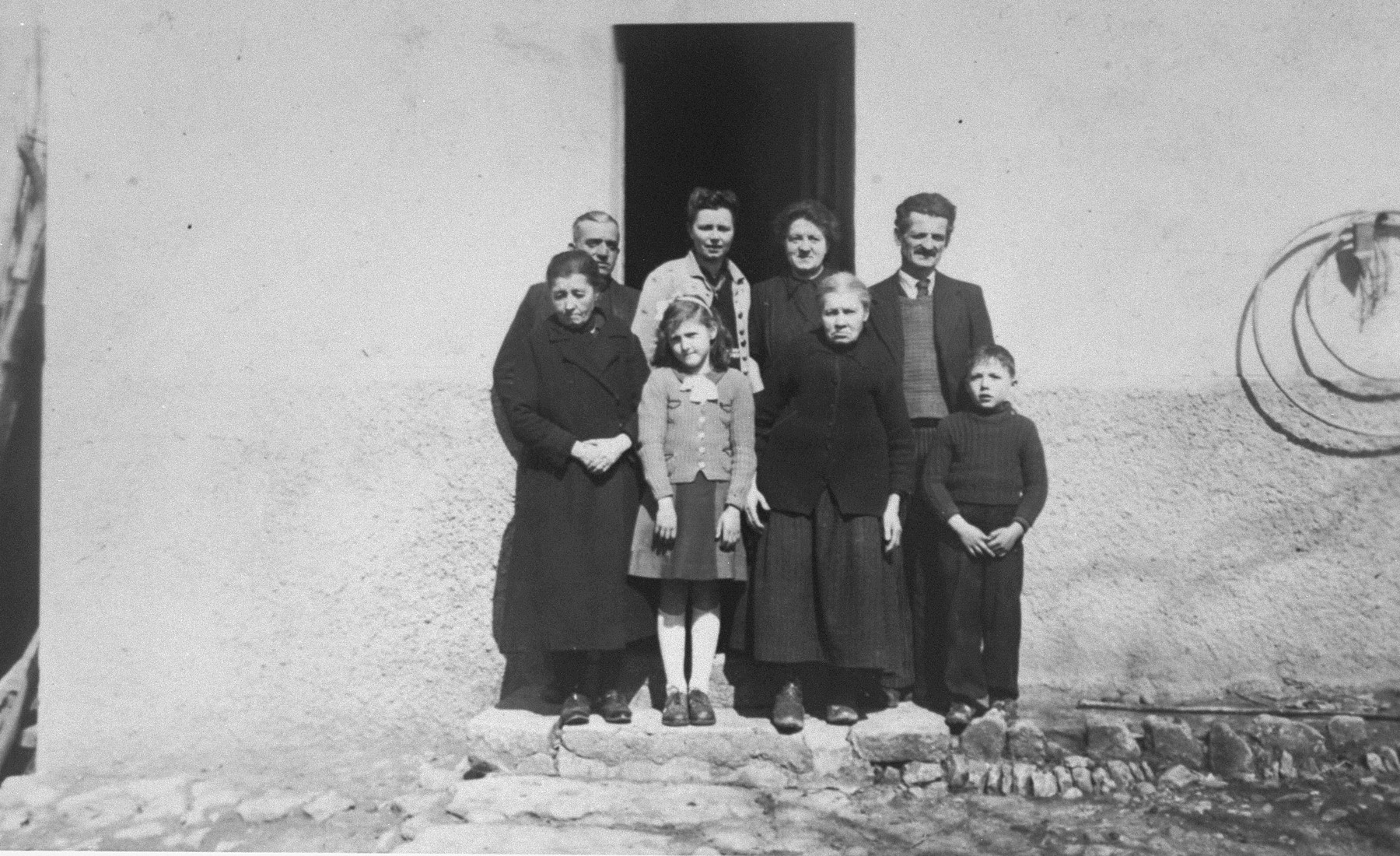 Berthe Lewkowitz (front, second from left), and her brother, Jacques (front right), with their rescuers, Victor and Josephine Guicherd (back right).