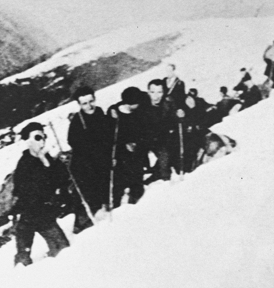 A group being smuggled out of France plows through snowdrifts on a rugged mountain pass in the Pyrenees.  The group was rescuted with the help of John Weidner's Dutch-Paris network.