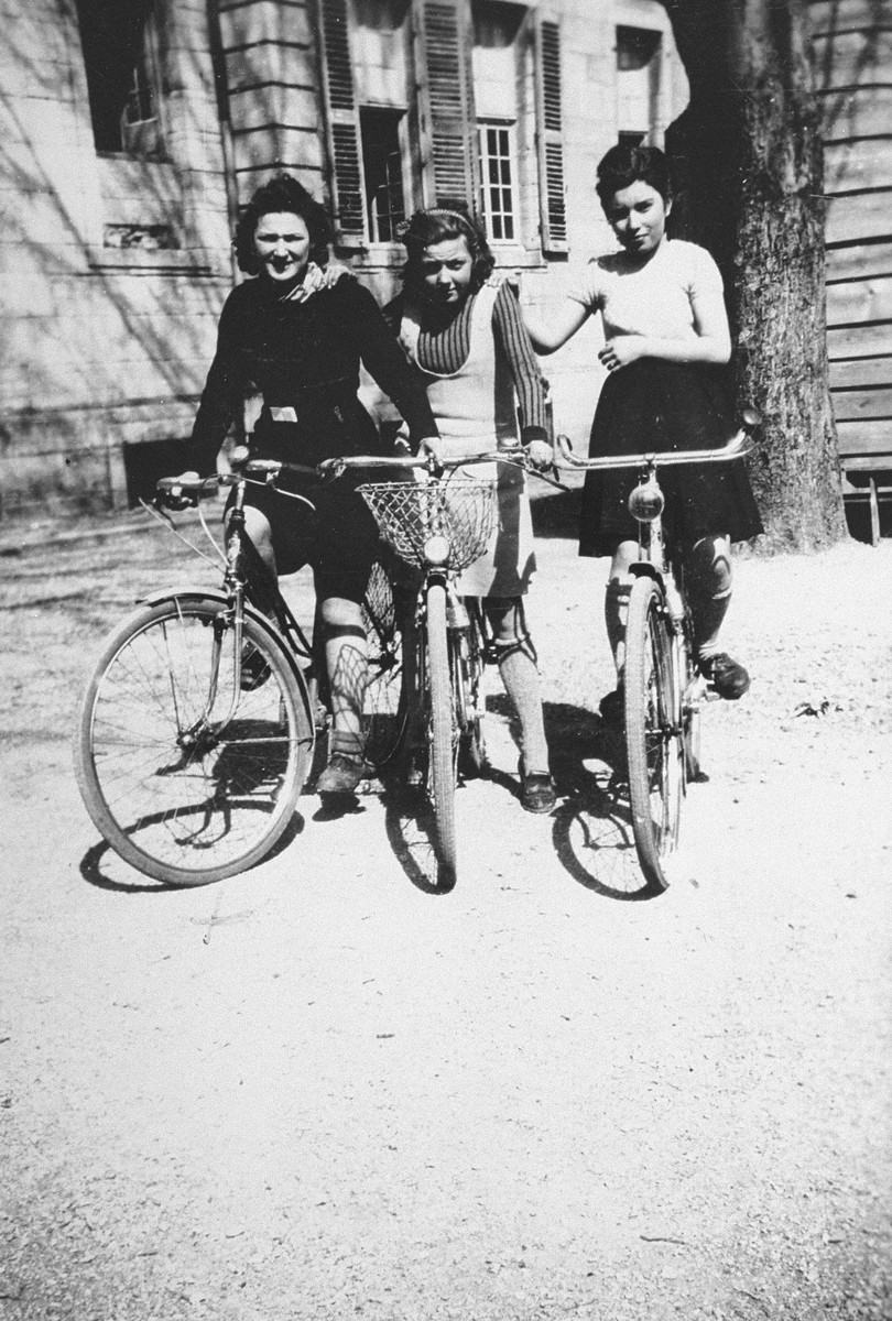 A Jewish teenager, Jacqueline Glicenstein (left), rides bicycles with two friends at a boarding school in Dole (Jura), France during the German occupation.