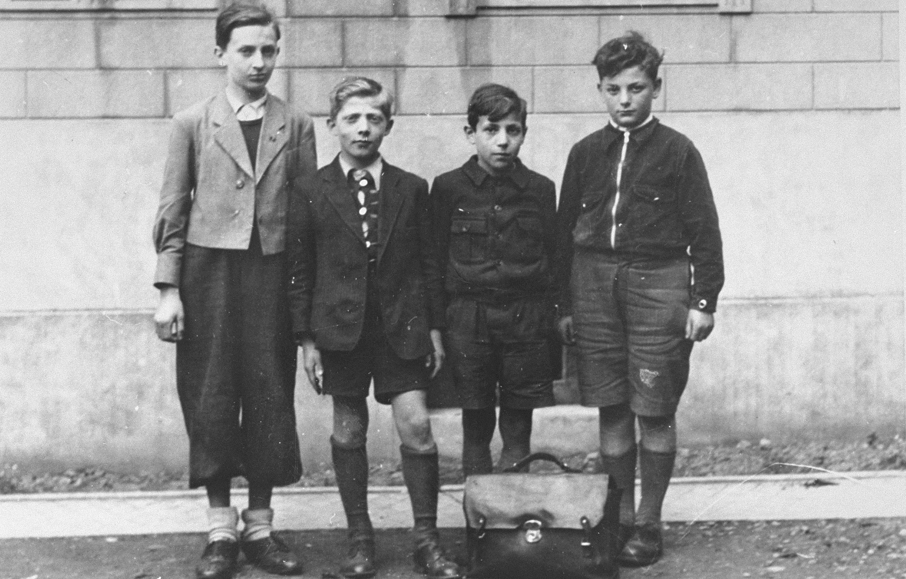 Group portrait of four Jewish boys who are being sheltered by Father Bruno.    Pictured from left to right are: Bernard Friedman, Leon Wygodski, Leon Chorvansky, David Rosenberg.
