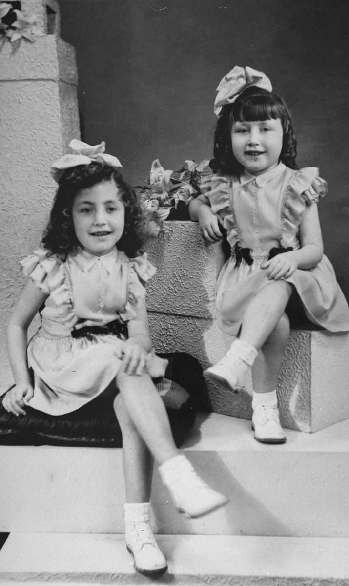 Formal portrait of Annette and Margo Lederman, two Jewish children in hiding, taken in the home of the van Buggenhout family.