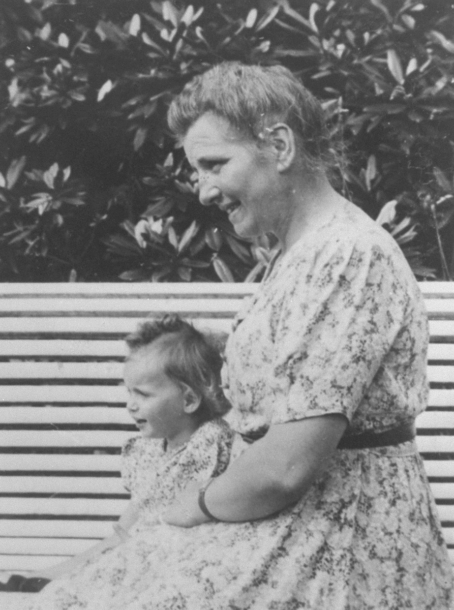 Belgian rescuer, Marie-Josephe Dincq, poses with Marguerite-Rose Birnbaum, a Jewish child she is hiding.