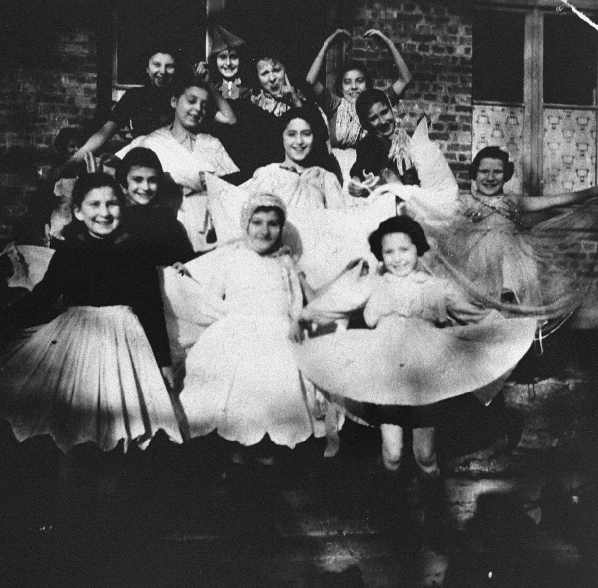 Gisele Warshawsky (second from left) poses with a group of children while in hiding at a convent in Sugny, Belgium.