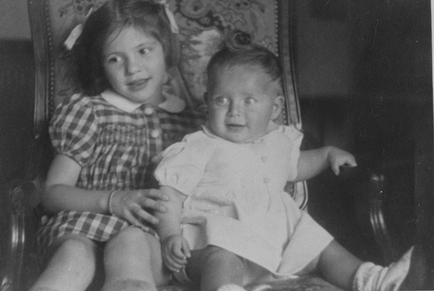 Marguerite-Rose Birnbaum (right) shares a chair with Marie-Ghislain Dincq, the daughter of her rescuer, Marie-Josephe Dincq.