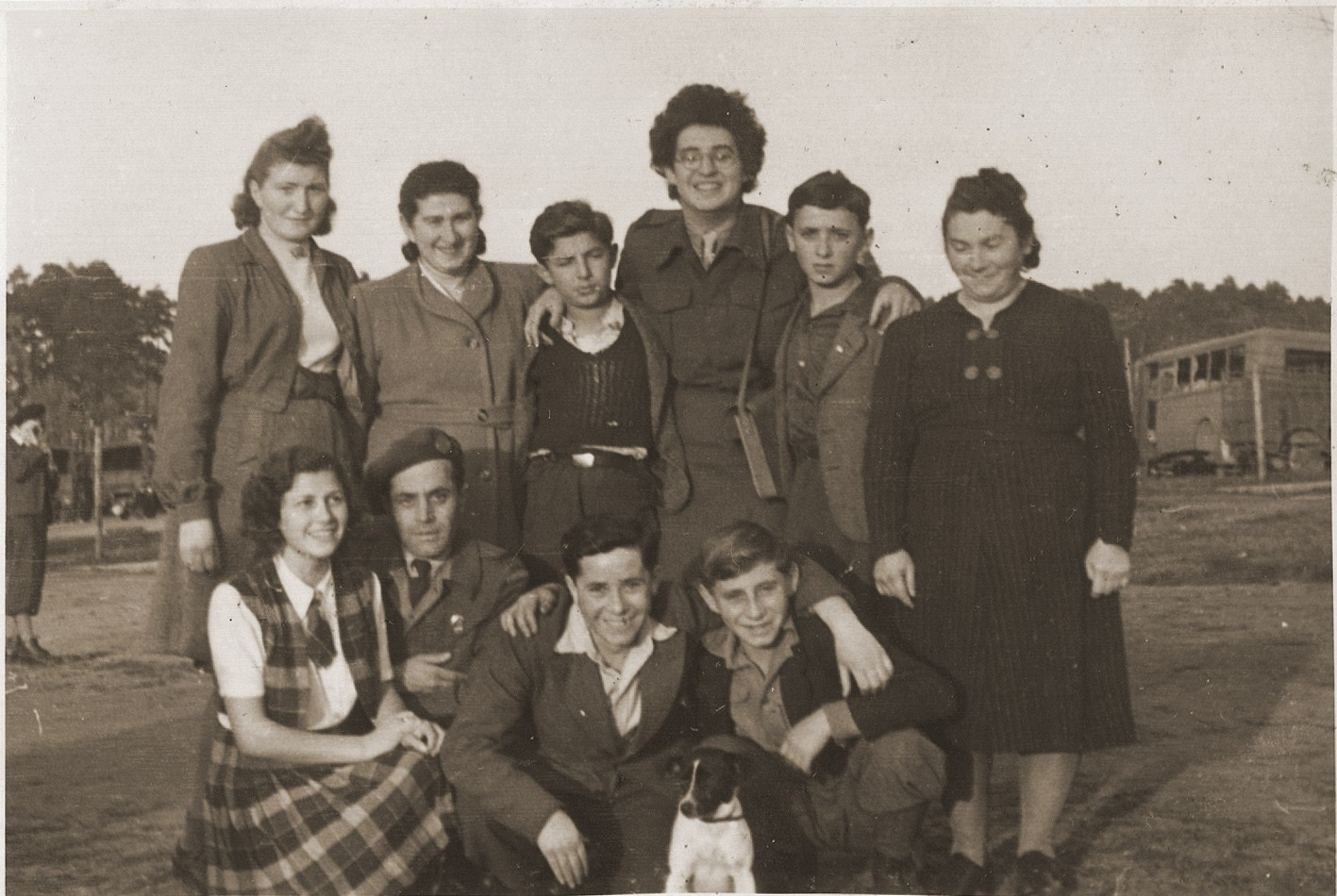 Group portrait of child and teenage orphans who are about to leave the Bergen-Belsen displaced persons' camp on the first authorized children's transport to Palestine.    The group sailed aboard the SS Champollion from Marseilles.