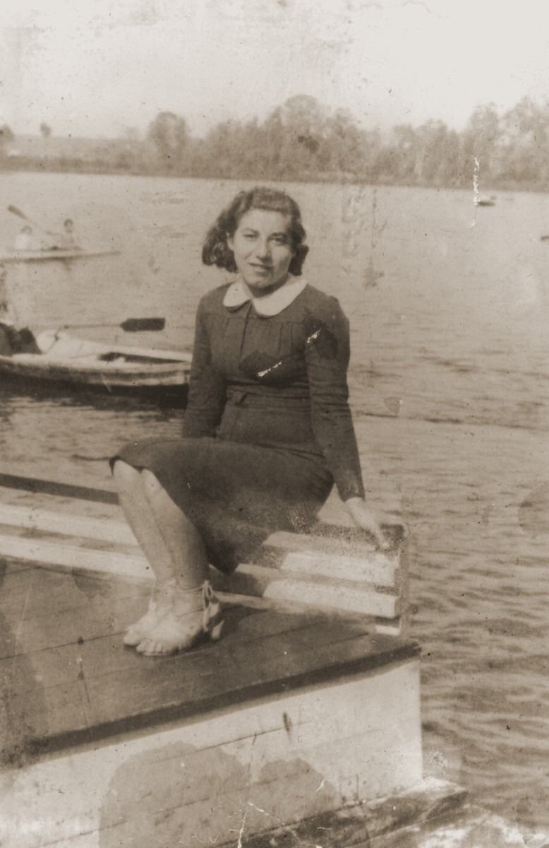 Rochelle Szklarski sits by a lake or river near the Bad Reichenhall displaced persons camp.