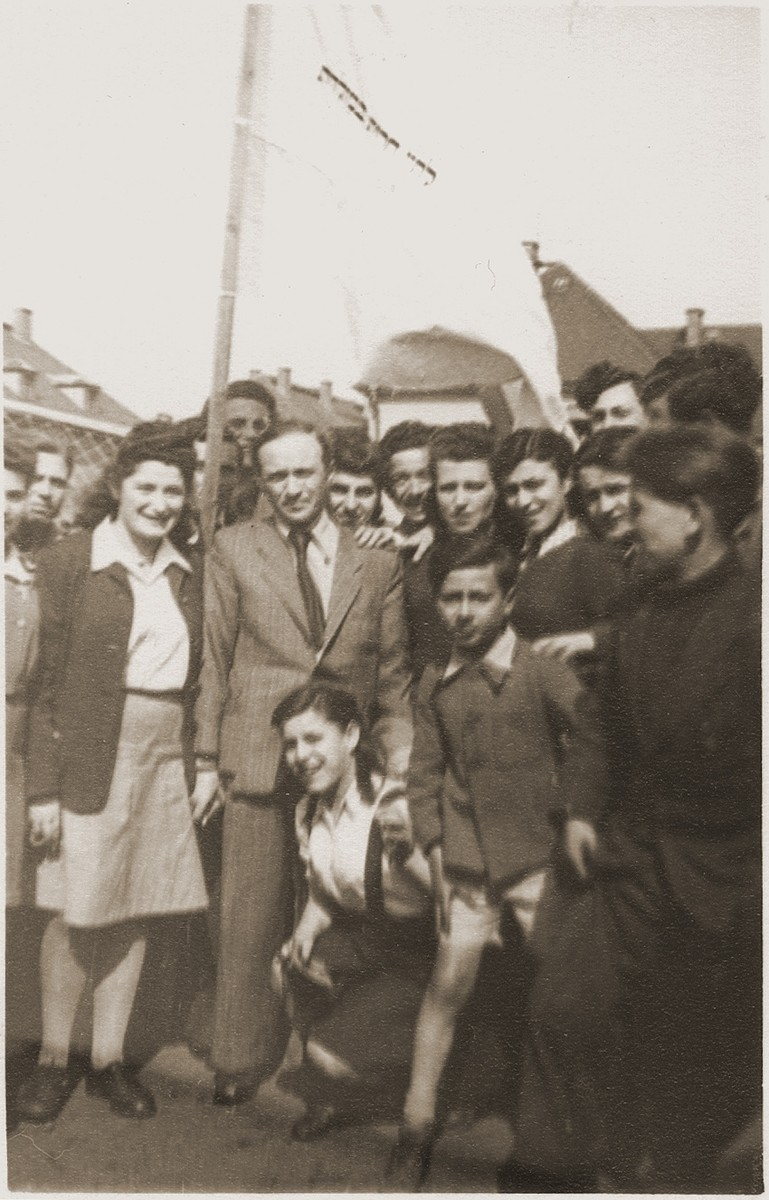A group of child and teenage orphans prepare to leave the Bergen-Belsen displaced persons' camp on the first authorized children's transport to Palestine.  The group sailed aboard the SS Champollion from Marseilles.