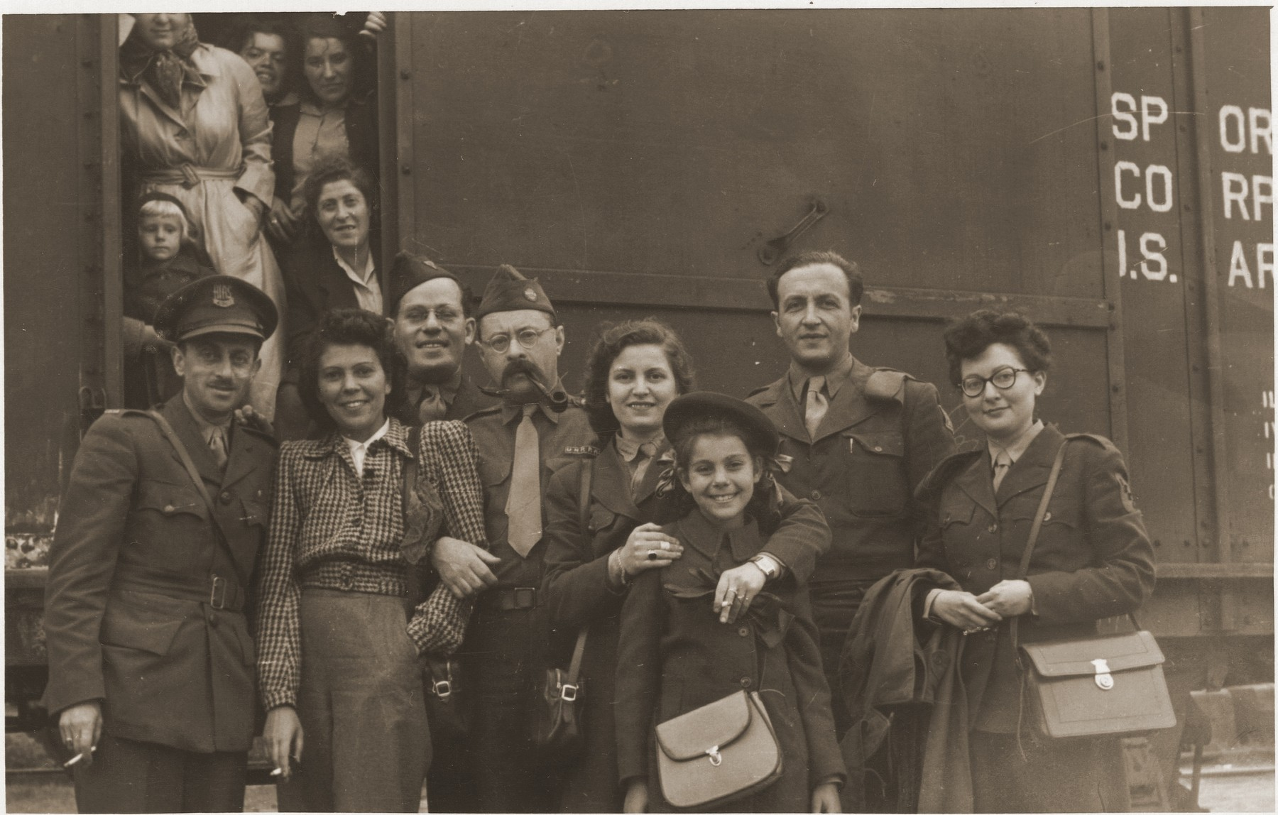Jewish DPs who are scheduled to depart for the U.S. aboard the Marine Flasher, pose in front of a train in Bremen.