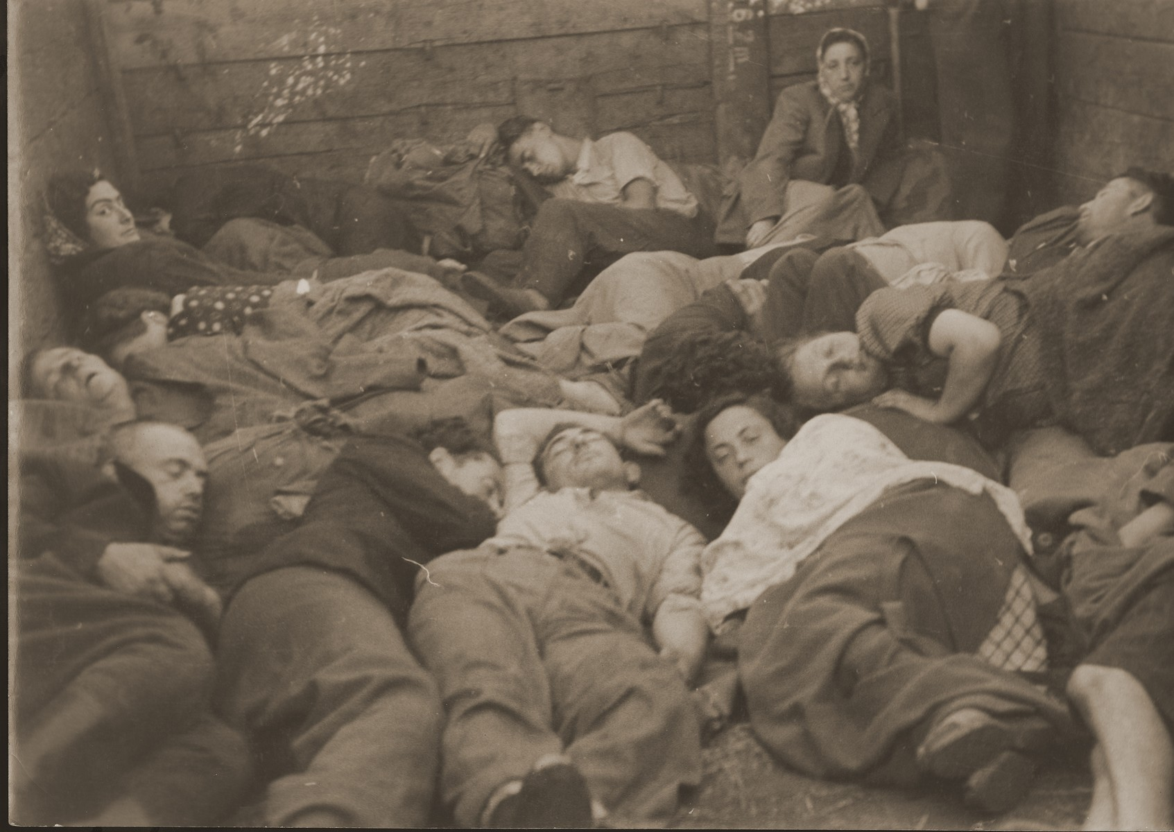 Jewish DPs who have fled from Poland, sleep in the box car of a train while on their way to the west.  [Oversized print]