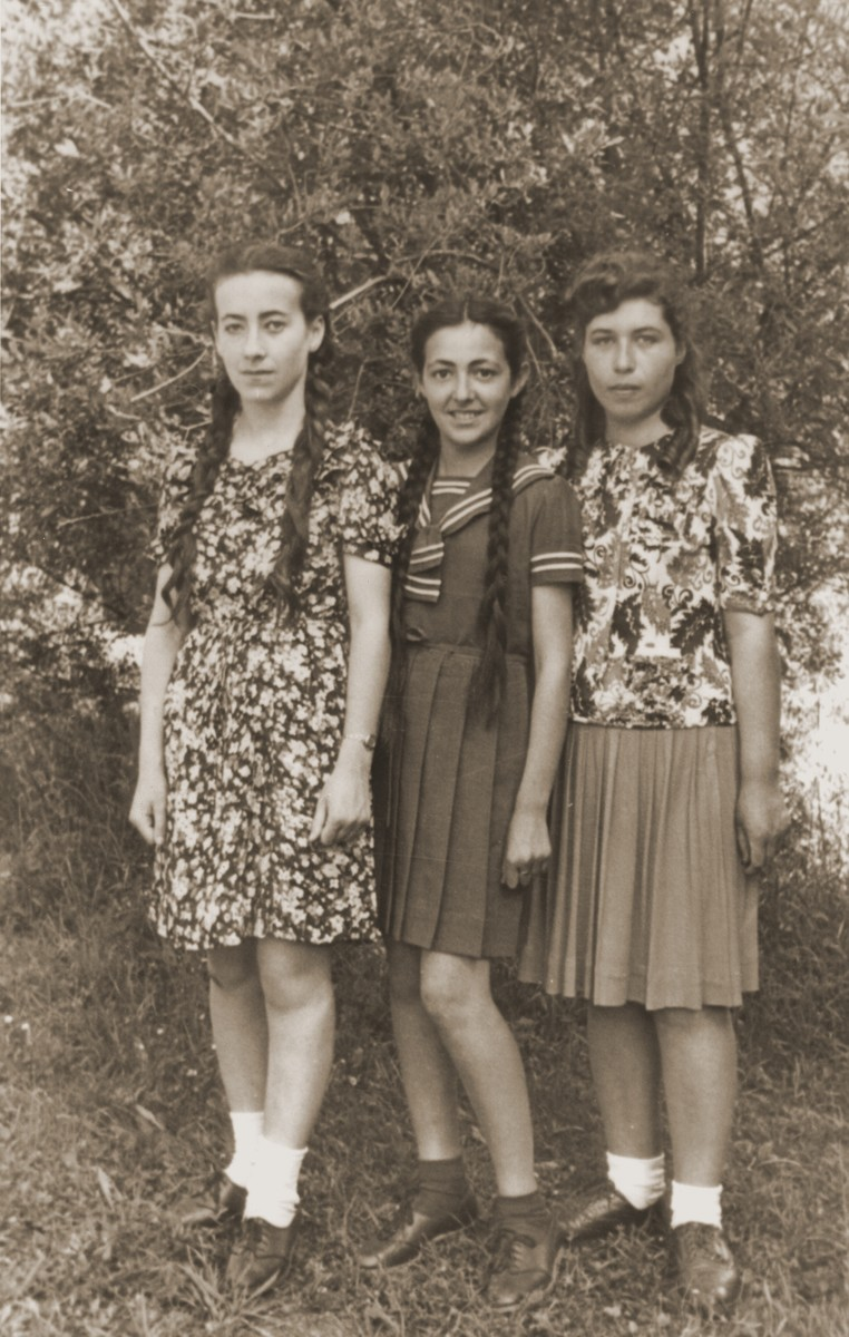 Close-up of three teenage girls in the Bad Reichenhall displaced persons camp.  Rochelle Szklarski, the donor, stands first from right, with her friend, Regina Lewkowicz and her sister.